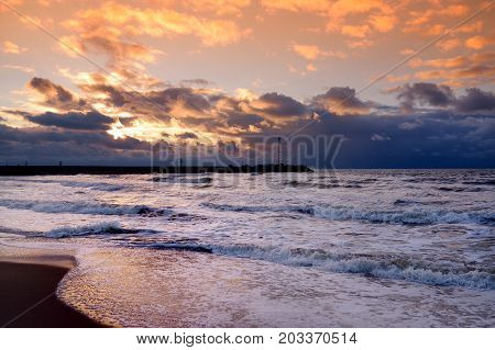Dramatic Sunset Over The Baltic Sea At Winter.