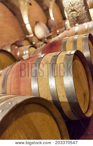 Wine Barrels Stacked  In The Old Cellar