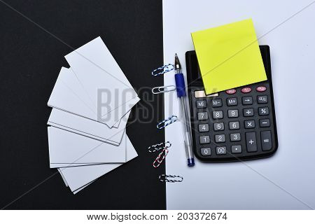 Yellow Notes, Blank Cards, And Clips Organised On Opposite Sides