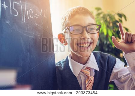 Back To School. Cute Child Sitting At The Desk In The Classroom. Boy Discover Important Information