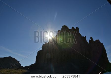 massive rock formations in northwestern new mexicos silhouetted by the sun