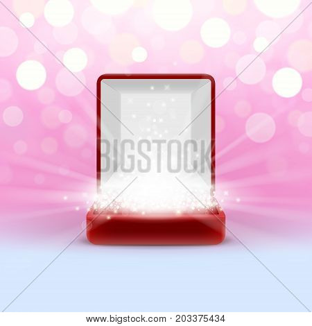 Open jewelry box with glowing from inside on abstract bokeh background. Wonderful power of jewelry. Place for jewel in glow. Template.