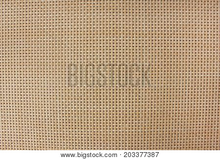 Light brown wood plank texture background. Antique bamboo weave pattern wallpaper with small squares. Empty detailed boarded frame structure close up. Natural material with blank copy space top view