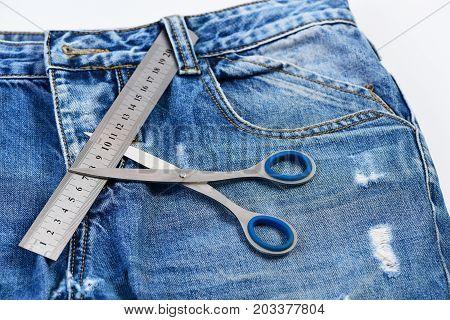 Tailors Tools On Denim Fabric: Metal Scissors And Ruler