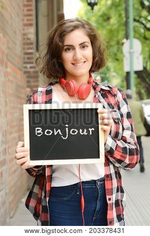 Woman Holding Chalkboard With Text
