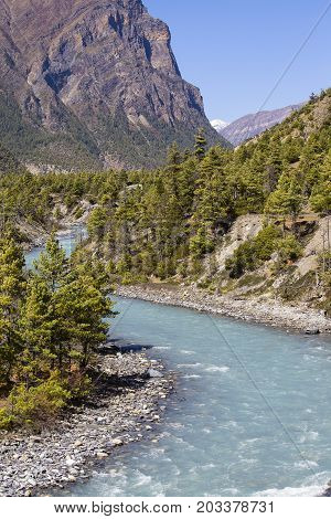 Beautiful mountain landscape in Himalayas Annapurna region Nepal. Sunny day of Nepal summer. Big mountain blue river and fresh air. Eco travel