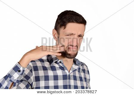 Man Holding Nose Against Bad Smell.