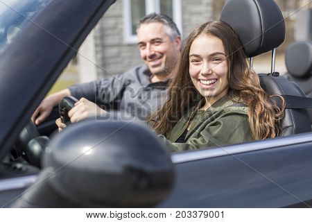 A Teen learning to drive or taking driving test.