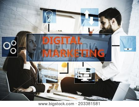 Young people at workplace with digital marketing screen. Technology concept