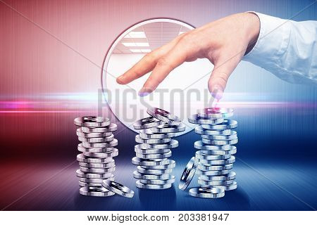 Male hand with silver coin piles in shiny bank vault. Wealth concept. 3D Rendering