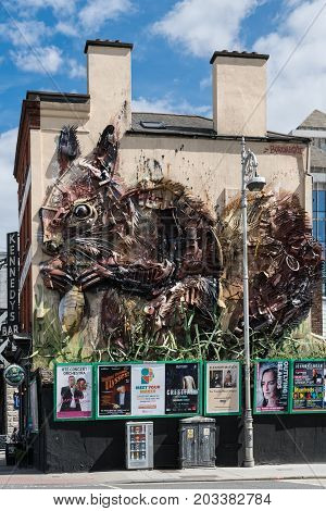 Dublin Ireland - August 7 2017: Art Work on facade of The Workshop Gastro pub off Butt Bridge shows giant squirrel made of recuperated metal rusted metal pieces. Event posters line on wall at street level.