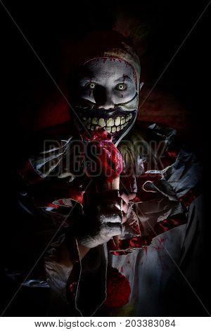 scary horror killer clown on Halloween night
