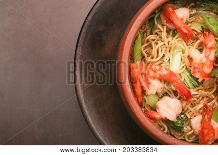 Top view of bowl of noodle with shrimps