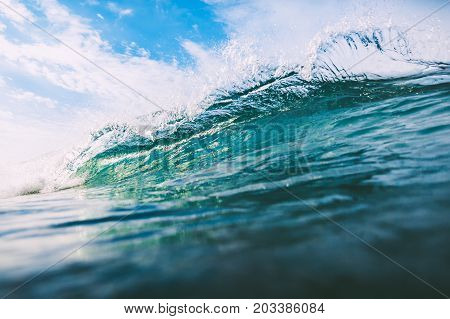 Crashing wave in ocean. Crystal wave and sun