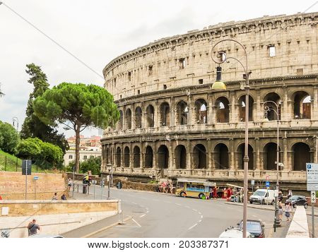 ROME, ITALY - AUGUST 30, 2013: Roman Colosseum, the most known sight of Rome and largest amphitheatre ever built. Rome, Italy