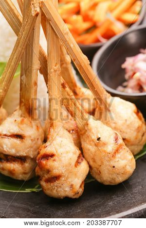 Minced meat skewers served on the table