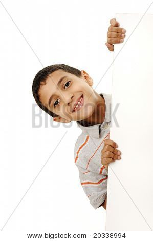 Portrait of a happy little boy holding a blank board against white background