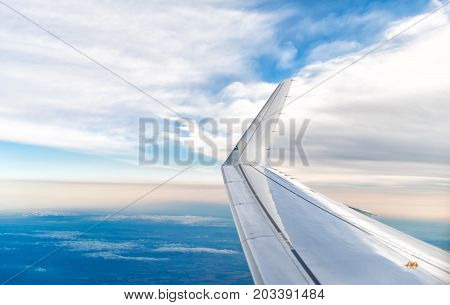 Wing of an airplane view from window.