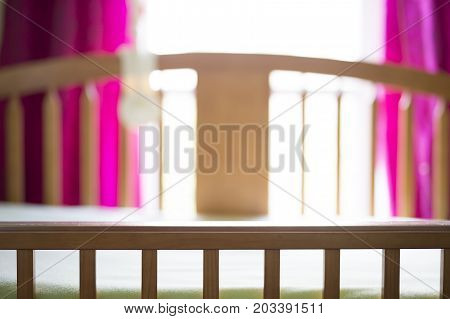 a nice cradle in baby room only close to window