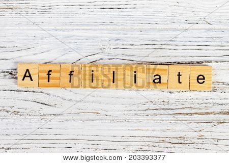 AFFILIATE word made with wooden blocks concept