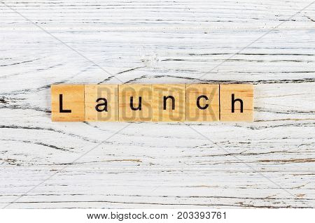 LAUNCH word made with wooden blocks concept