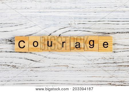 COURAGE word made with wooden blocks concept