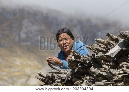 HIMALAYAS ANNAPURNA REGION NEPAL - OCTOBER 15 2016 : Unidentified old Nepalese woman in a Himalayan village in Nepal