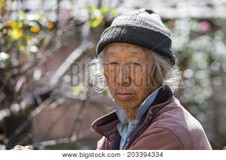 HIMALAYAS ANNAPURNA REGION NEPAL - OCTOBER 13 2016 : Portrait old man in traditional dress in Himalayan village Nepal