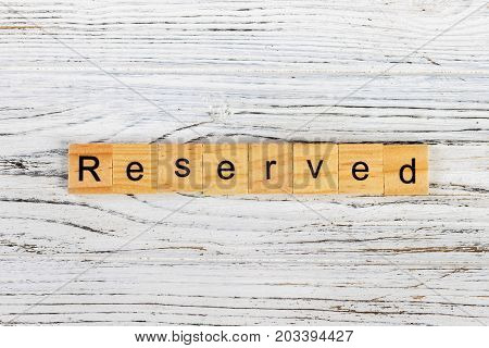 RESERVED word made with wooden blocks concept