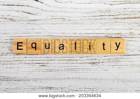 EQUALITY word made with wooden blocks concept