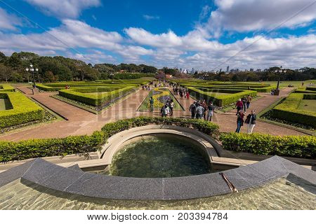 Curitiba, Brazil - July 20, 2017: People walk in the famous park of Botanical Garden. The garden was opened in 1991 and covers 240.000 m2 in area.