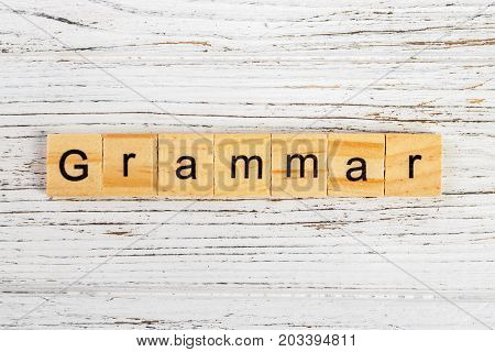 Grammar word made with wooden blocks concept