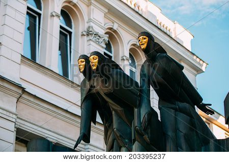 Vilnius, Lithuania, Eastern Europe - July 7, 2016: Close Up Of Black Sculpture Of Three Muses On Facade Of Lithuanian National Drama Theatre Building, Main Entrance