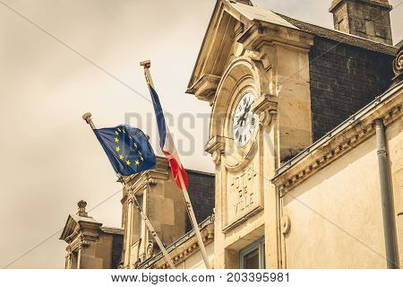 Architecture Detail Of The Town Hall Of Noirmoutier, France With Its Clock