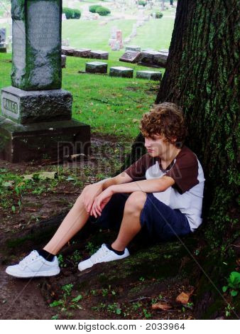 Young Teen Sitting In Cemetary