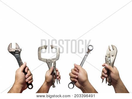 The hands of many mechanic holding instruments tools isolated on white background with copy space Mechanic tools concept Adjustable wrenchLocking pliersC-Clamp PliersRatchet wrench