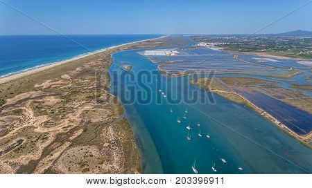 Aerial. Breakwater channel in Quatro aguas, Tavira Island. View from sky