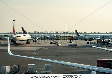 NEW YORK - AUGUST 17, 2017: View of Delta Airlines plane on tarmac at Terminal 4 at JFK International Airport