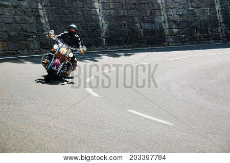 ALPS, AUSTRIA - 27.08.2017: Motorcycle on Country road to Grossglockner at the european alps in Austria