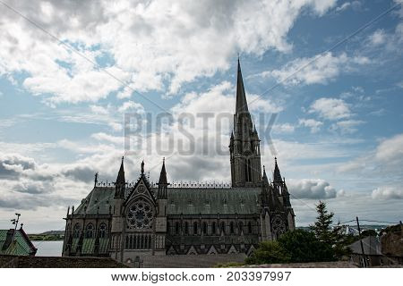 COBH, IRELAND - AUGUST 19, 2017: View of St. Colman's neo-Gothic cathedral, Cobh, South Ireland