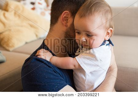 Father Comforting Crying Baby