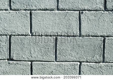 Grey concrete brick wall photo background. Rough grey stone brick. Masonry wall made of big block. Rustic stone texture. Industrial stone brickwork. Solid protection safety or durability concept