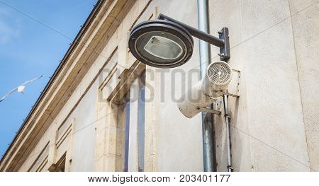Black City Lamp Post And Loudspeakers Hanging On A Wall