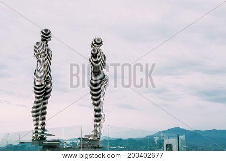 Batumi, Adjara, Georgia - May 22, 2016: A moving metal sculpture created by Georgian sculptor Tamara Kvesitadze in 2007, titled Man and Woman or Ali and Nino.