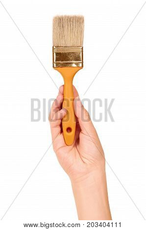 Orange Paint Brush In Hand Isolated On White Background