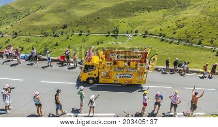 Col de PeyresourdeFrance- July 23 2014: BIC vehicle passing in the Publicity Caravn on the road to Col de Peyresourde in Pyrenees Mountains during the stage 17 of Le Tour de France 2014.