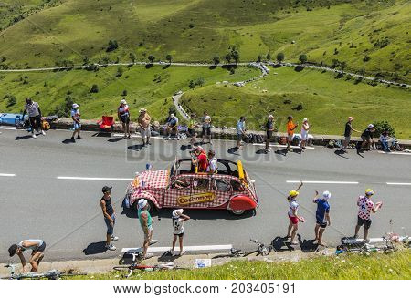 Col de PeyresourdeFrance- July 23 2014: Cochonou vehicle passing in the Publicity Caravn on the road to Col de Peyresourde in Pyrenees Mountains during the stage 17 of Le Tour de France 2014.Cochonou is an important French brand of short dry sausages.