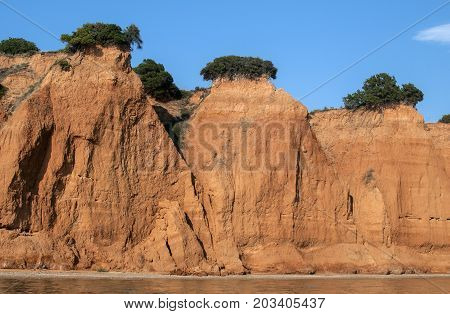 Effects of seaside coastal erosion with clayey soil