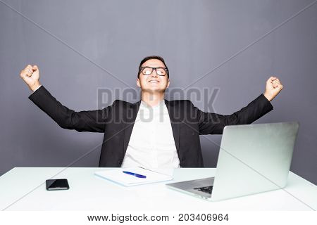 Happy Businessman Completed Task And Triumphing With Raised Hands
