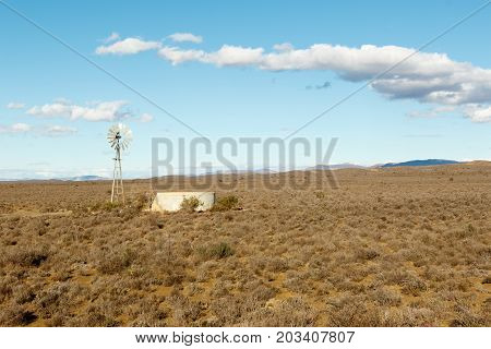 Windmill In The Fields Of Central Karoo District